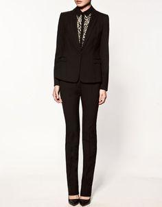tuxedo-style blazer and slim pants.