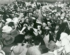 New Orleans native Louis Armstrong is greeted by throngs of fans as he makes his entrance as King Zulu during Mardi Gras on March 3, 1949.