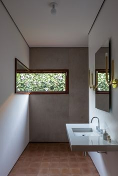Ipe wood frames contrast with the concrete floors