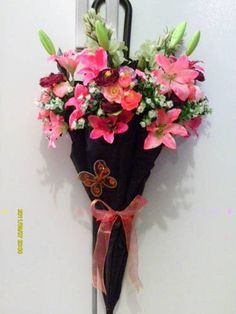 An umbrella as a hanging vase. Love it!