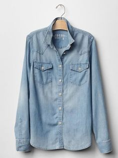The key to pulling off the Canadian tuxedo starts with having the right top. Shop the 15 best denim shirts, including this Gap 1969 Destructed Western Denim Shirt.