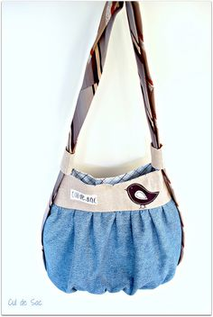 Eco-friendly versatile shoulder and backpack bag by Bouclenoire, via Flickr -  made with denim, mens shirt, bed sheet, interfacing and neckties