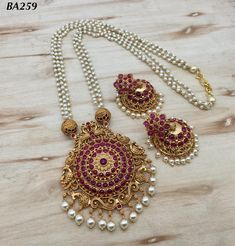 Temple jewellery available at AnkhJewels for booking WhatsApp on Pearl Necklace Designs, Jewelry Design Earrings, Gold Jewellery Design, Beaded Jewelry, Pearl Jewelry, Gold Jewelry, Gold Bangles, Bridal Jewelry, Gold Earrings