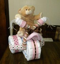 Tricycle Diaper Cake: This adorable tricycle diaper cake can be made for boy, girl, and can be made using your favorite color. Makes a great gift for a new baby or beautiful