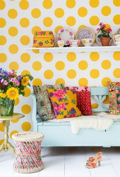 A polka dot wall or small wall would be so cute! I would not use yellow, but instead would use the perfect shade of pink!