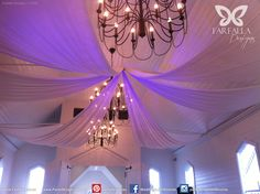 White Ceiling Drapery with Up-Lighting  http://partydesign.com.au/ceiling_decor.html