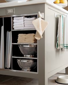 """Decide what you want to keep in the islands, and plan the space accordingly. """"Upright steel slats provide perfect spots for heavy baking sheets,"""" Martha says. She also has drawers for aprons and utensils; deep shelves for platters, books, and pet supplies; and small cubbies for towels and other items."""