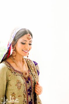 Stunning Pakistani Bride in a soft green bridal ensemble. Her gold jewelry accents her look perfectly! #pakistanibride #uzbin #muslimbride