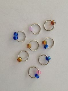 How to make beaded stitch markers - dot of glue over opening of jump ring, then slide bead over the glue