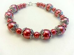 Hey, I found this really awesome Etsy listing at https://www.etsy.com/listing/210040252/red-pearl-bracelet-burgundy-pearl