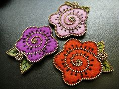 Pretty felt broaches by woolly fabulous, I really like the look of these.