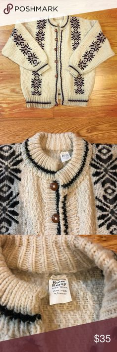 Vintage ivory & black Men's wool Nordic sweater Vintage ivory white & black Men's wool sweater from Artesanias Runa Ruray. The sweater is 100% wool and hand made in Ecuador. The body of the sweater is knit & woven white wool with vertical Nordic patterns in black on the front, back, and sleeves. Brown, wooden-like buttons on the front button-down part of the sweater. Ribbed hem, cuffs, and collar. The sweater is worn with use, with some color-bleeding and matting in some places, but this is…