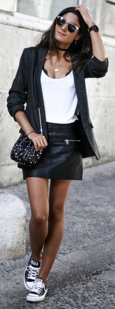 leather skirt + biker chick look + Federica L. + sleek monochrome colour scheme + blazer and skirt outfit + classic black converse. Blazer: Zara, Skirt: Mango, Shoes: Converse.