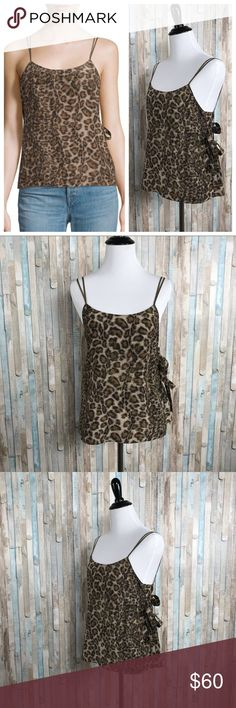 Helmut Lang S Leopard 100% Silk Overlay Tank Top You're looking at a pretty camisole by Helmut Lang.  -Allover leopard animal print in brown hues; double spaghetti strap; wrap top camisole (wraps in back). This pretty tank makes for a great layering piece (like under a blazer!)  -Size small   -100% silk  -Brand new with tags  $320 retail Helmut Lang Tops Tank Tops