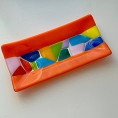 Fused glass plate in orange with an eyecatching, colorful centerstripe Slumped Glass, Fused Glass Plates, Fused Glass Art, Glass Dishes, Stained Glass Birds, Stained Glass Crafts, Stained Glass Panels, Glass Fusion Ideas, Glass Fusing Projects