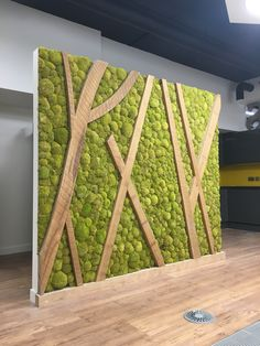 Preserved bunn moss wall screen/divider in client's breakout area Nice with the combination fo wood & moss. Moss is said to help with air quality and sound dampening. Moss Wall Art, Moss Art, Vertikal Garden, Vertical Green Wall, Deco Restaurant, Lobby Design, Green Architecture, Plant Wall, Green Building