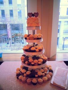 Tiers of cupcakes on a tower stand instead of a tiered cake is always a fun way to go!