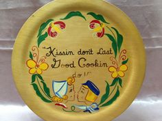 """Pennsylvania Dutch Wooden Plate 12"""" Sixties Kissin Don't Last Good Cookin Do by Woodcroftery on Etsy, $14.00"""