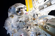 Aug. 23, 2016 Spacewalkers Successfully Install New Docking Adapter for Commercial Crew Flights Astronaut in spacesuit working outside space station with solar array in background