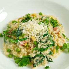 Roasted garlic risotto recipe with pancetta, spinach, peas and rosemary. Italian comfort food!