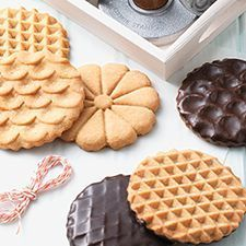 Peanut Butter Stamp Cookies. Decorative peanut butter cookies with a dark chocolate glaze.