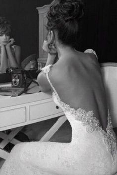 gorgeous low-cut wedding dress back~ I WILL wear something like this... someday!:)