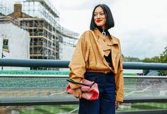 Tiffany Hsu in a Loewe jacket and J.W.Anderson sweater with a Loewe bag