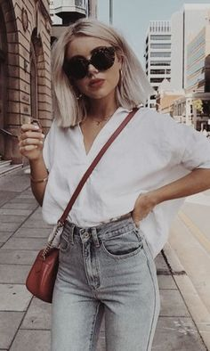 tortoise shell sunnies + white shirts + high rise levis 501 skinny jeans + red crossbody | #ootd #womensfashion #streetstyle
