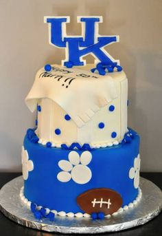 Charlotte, I found Mark's 50th bday cake!! We could just put basketballs instead of footballs of course! Already has his name on it! LOL