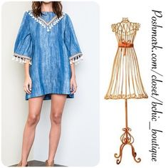BOHO Style Denim shift Dress Elegant yet stylish Boho Denim Dress by April Spirit. White tassels on the sleeve. Can be worn as a dress or paired with leggings.   70% Cotton 30% Polyester April Spirit Dresses