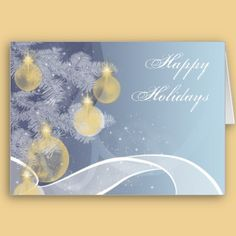 A beautiful card perfect for wishing your friends and family Merry Christmas. The background has a gradient from a darker blue to a light blue with blue and white ribbons of color. To the left side there are pine branches in white with gold ornaments with a dusting of snow. Inside is a lovely greeting and your customizable text. $3.55