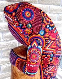 Huichol Bead Art Symbols | Closeup of beaded double iguanas on post