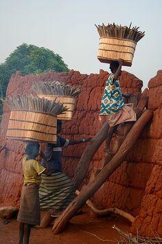 Women carrying sorghum, Lobi country, Burkina Faso