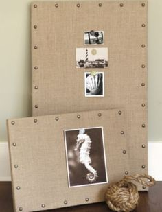 burlap over a foam board with antiqued tacks.