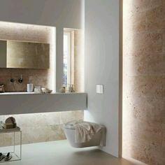 #Diseñointerior de sala de #baño con juego se #luces indirectas en techos paredes y #mobilliario. Es recomensable que las paredes rn blanco se revistan de material resistente y de acabado pulido para...
