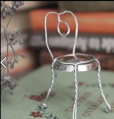 Fairy Chair - made from champagne cork wire... good excuse to open a bottle of bubbly!