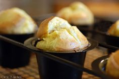 """Parmesan-GarlicPopovers       Popovers crack me up. It's really very difficult to take them seriously, when the moment you take them out of the oven looking all gorgeous and sophisticated, they immediately collapse and are like """"just kidding!"""" Because really there's nothing very sophisticated about them at all. They're a total breeze to throw together and they're one baked good whose appearance you never have to apologize for. No matter how perfectly you cook th"""