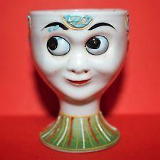 Coquetier ancien Porcelaine visage