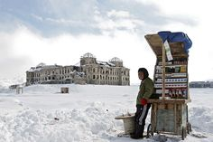 Selling cigarettes in winter. Darul Aman Palace - Kabul, Afghanistan.