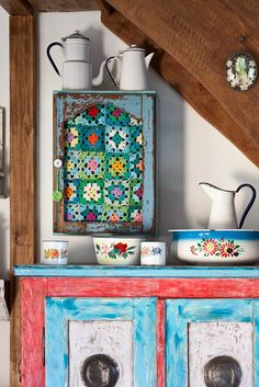 Gotta check out this blog - especially if you love blue!! I love this cabinet that has a granny square insert!
