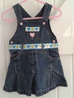 BABY BLUES 'All heart' dress. Heavy denim,now made unique with ribbon 'heart' interest to belt and pockets front & rear.   3-6 MONTHS         £10.00