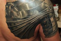OMG!!!!! This 3D armor shoulder tattoo by Levgen Knysh looks so damn real!