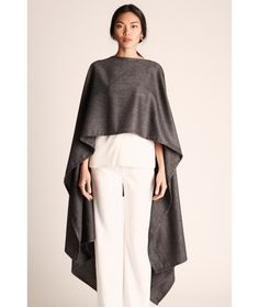 Ever wish you could glide through the city looking like Audrey Hepburn meets Wonder Woman? Our elegant Natalia Poncho is the perfect mix of confidence and grace. The lightweight wool blend is just right to keep the chill off on cool spring and summer nights.