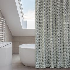 Add a wow factor to your bathroom decor with this Metro shower curtain set. This curtain features a multicolored beige and grey chevron design on water repellent fabric and comes with twelve rings and a liner.