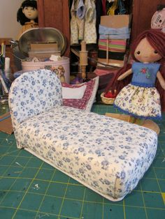 A picture tutorial for making dollhouse furniture from cardboard, foam, batting, fabric, glue, and other odds and ends