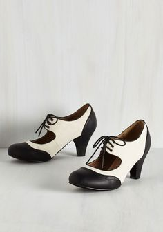 It's a Sure Fete Heel in Ivory and Noir. From birthday bashes to casual dates, you better believe these vegan faux-leather heels are a reliably stylish pair to wear!  #modcloth