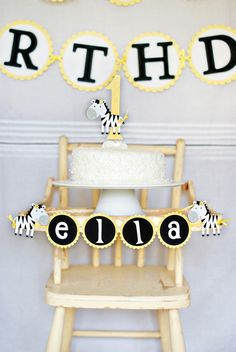 Perfect Set-Up for a first birthday!  Sassy Zebra High Chair Banner and Smash Cake Topper by http://pinwheellane.etsy.com
