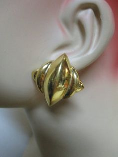 ead5dac4227 Vintage 70s YSL Yves Saint Laurent sculpted Gilt Pierced Earrings