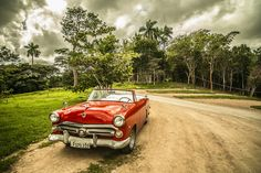 Vintage car in a Cuban forest