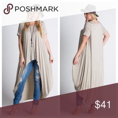High-Low Short Sleeve Top High-low top in a lightly heathered oatmeal jersey. Soft, with some stretch. EVIEcarche Tops